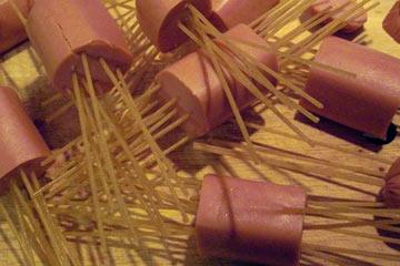 Spaghetti Poked Through Hot Dogs